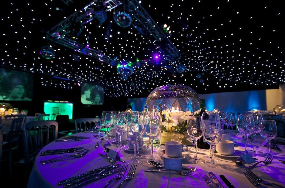 mobile night( )club hire in Kent showing off table decoration and planning. Beautiful presentation for your party or wedding with star cloth and truss lighting rig