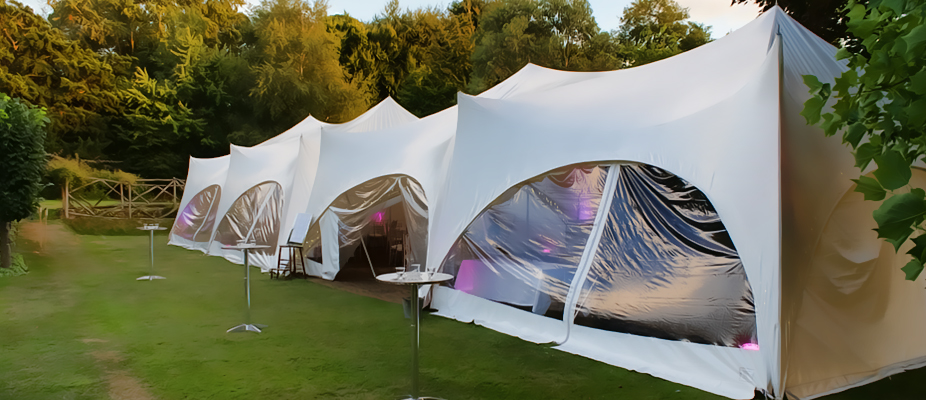 Stretch tents and capris are made from waterproof fabric and can be put up in an endless variety of shapes to provide an exciting and dramatic alternative to your standard marquee. These marquees do not use ropes and guy lines and are designed to look and feel modern and spacious. If you want to keep it simple without adding lining and décor extras, why not opt for one of these eye-catching marquees that are a statement themselves.
