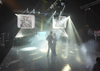 Double Video Screens and overhead truss lighting rig for a large Wedding first dance
