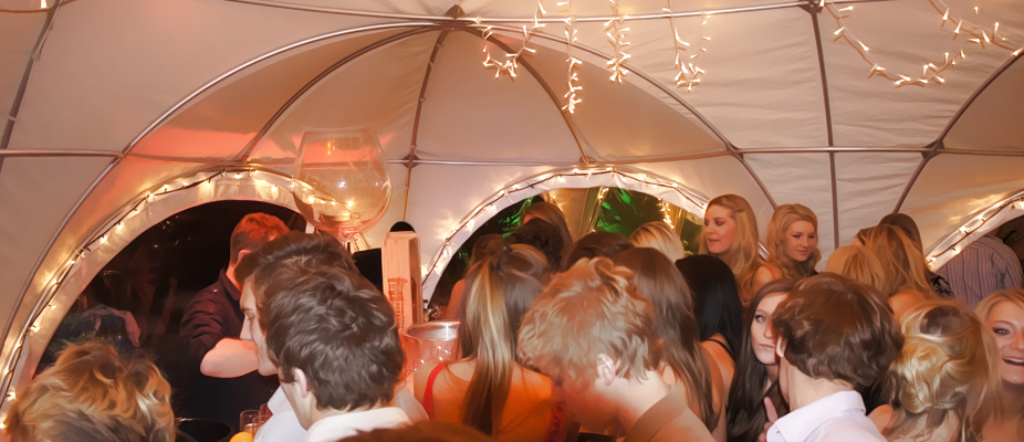 party planning and marquee hire in Kent, party with guests in a marquee decorated in lights