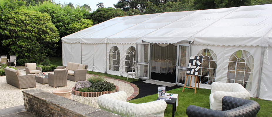 Framed tents are the most versatile marquees available. They can be erected within a few hours on a number of terrains such as grass or concrete. There are no centre poles and using extended raised legs we can turn a standard 2.4mtre leg to a 3mtr leg, therefore raising the height of the roof and giving the illusion of more space. Hard wooden windows and glass doors can be put into a frame tent to add to the look. We carry a full range of accessories to enhance the marquee, including a star clothed roof lining (for the twinkling night sky effect), LED colour changing uplighters, giant mirror balls, chandeliers and pin spot lighting, various coloured carpets and furniture.