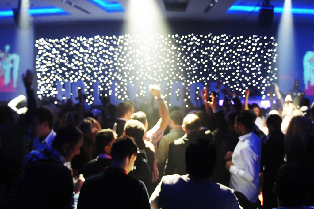 guests at a party having fun on the dance floor, they are under the lighting rig and surrounded by star lock cloths giving the impression of stars. All equipment for hire is available in our wedding planning or part planning in Kent.