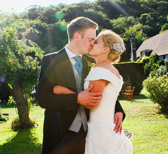 bride and groom sharing a kiss after their wedding ceremony. We are the number one wedding planner in Kent and we love what we do. We can provide you with DJ for hire for your special day and advise on venues around the south east of england