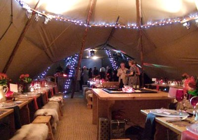 Inside a tipi marquee at wedding reception