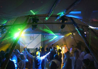 Lighting up the dancefloor in the tipi marquee with lots of guests dancing
